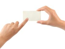 Paper card and pointing hand Stock Photography