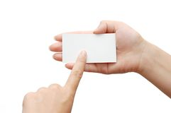 Paper card and pointing hand Royalty Free Stock Photo