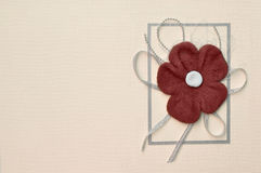 Paper card with red suede flower design Royalty Free Stock Photography