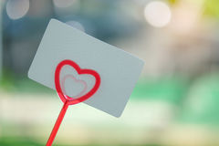 Paper card on rod heart for valentine. Stock Images