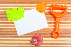 Paper card seashells  and toys on wood Stock Photos