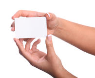 Paper card in woman hand isolated on white background Stock Photography