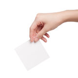 Paper card in woman hand Stock Images