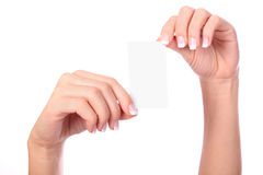Paper card in woman hands Stock Images
