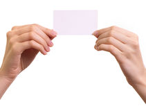 Paper card in woman hands isolated Royalty Free Stock Images