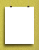 Paper card on a yellow wall. Royalty Free Stock Photography