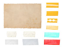 Paper cardboard with tape strips isolated on white background Stock Photos