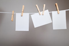 Paper cards on clothes-pegs Stock Photo