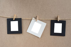 Paper cards hang on rope by wood clip. Stock Photography