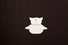 Paper cat applique. Cute Buddah cat on textured background Stock Photography