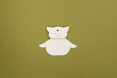 Paper cat applique. Cute Buddah cat on textured background Stock Photos