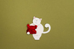 Paper cat with gift box applique. Cute little cat applique on texture background Stock Photo