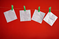 Paper CD envelopes hanging isolated on a red background Royalty Free Stock Photography