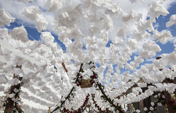 Paper ceiling at Campo Maior Festival, Portugal. Flower festival in Campo Maior with paper flowers decorared streets,  Portugal Royalty Free Stock Photo