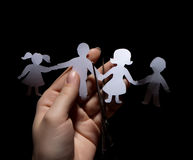 Paper chain family. Divorce  on black background Stock Photos