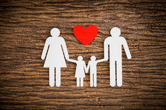 Paper chain family and red heart symbolizing Stock Photos