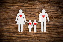 Paper chain family and red heart symbolizing Stock Images