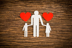 Paper chain family and red heart symbolizing Royalty Free Stock Image