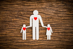 Paper chain family and red heart symbolizing Royalty Free Stock Photos