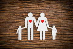 Paper chain family and red heart symbolizing Royalty Free Stock Photography