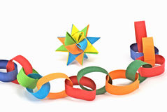 Paper chain and paper star Royalty Free Stock Image
