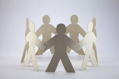 Paper chain people. Paper cutout people linked together Royalty Free Stock Photo