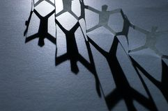 Paper Chain People. A line of paper chain people Royalty Free Stock Photo