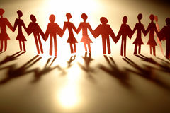 Paper-chain people. Holding hands, studio shot Royalty Free Stock Photo