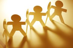 Paper chain team united. Team of paper chain people Stock Photo