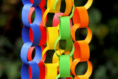 Paper chains. Bunch of colorful paper chains for decorating hanged on a tree royalty free stock photography