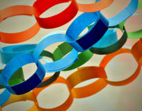 Paper chains. Coloured paper chains for decoration composed diagonal Stock Photo