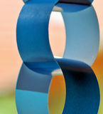 Paper chains. Detail of paper chain in blue color Royalty Free Stock Photo