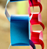 Paper chains. In red and blue color Royalty Free Stock Photography