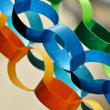 Paper chains. In vibrant blue, green and yellow Stock Images