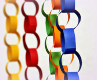 Paper chains. In  vibrant colours  on a bright background Stock Photos