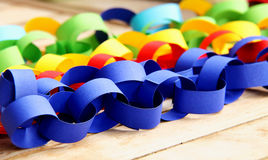 Paper chains. In a vibrant colours on the table Stock Image