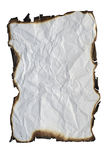 Paper with charred edges. Image of the crumpled paper with charred edges - isolated royalty free stock images