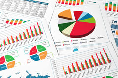 Paper charts and graphs in report Stock Photography