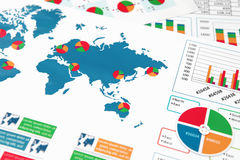 Paper charts and graphs in report. Financial paper charts and graphs in report Stock Photos