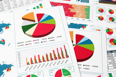 Paper charts and graphs in report Stock Images