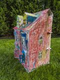 Paper children house made by corrugated fiberboard.Kid toy. Paper children house made by corrugated fiberboard. Kid toy colored and painted with pastels royalty free stock images