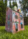 Paper children house made by corrugated fiberboard.Kid toy. Paper children house made by corrugated fiberboard. Kid toy colored and painted with pastels royalty free stock image