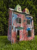 Paper children house made by corrugated fiberboard.Kid toy. Paper children house made by corrugated fiberboard. Kid toy colored and painted with pastels royalty free stock photography