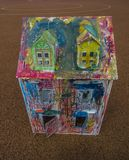 Paper children house made by corrugated fiberboard.Kid toy. Paper children house made by corrugated fiberboard. Kid toy colored and painted with pastels stock images