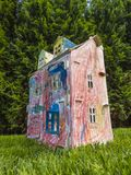 Paper children house made by corrugated fiberboard.Kid toy. Paper children house made by corrugated fiberboard. Kid toy colored and painted with pastels stock image