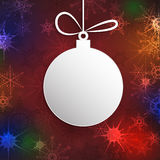 Paper Christmas ball with space for text.Christmas Greeting Card.Red decorative snowflakes background Stock Images