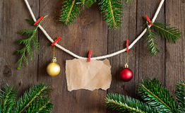 Paper and christmas decorations on pins Stock Photos