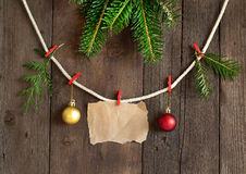Paper and christmas decorations on pins Royalty Free Stock Photo