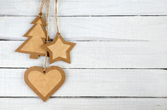 Paper Christmas decorations on wood Stock Photo