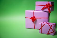 Paper Christmas gifts on green background. Christmas holidays background with copy space for your text royalty free stock photo